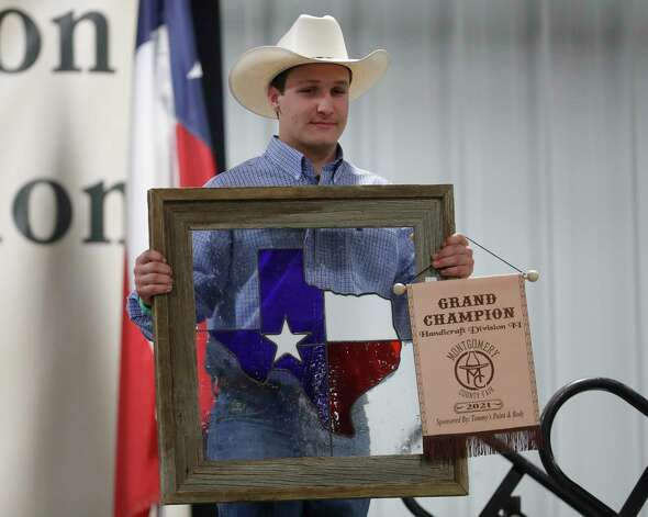 Anthony Okonski of Splendora High School won grand champion handicraft II for his Texas themed cedar frame with stain glass window during the non-livestock auction at the Montgomery County Fair and Rodeo, Monday, April 12, 2021, in Conroe. Photo: Jason Fochtman, Houston Chronicle / Staff Photographer / 2021 © Houston Chronicle