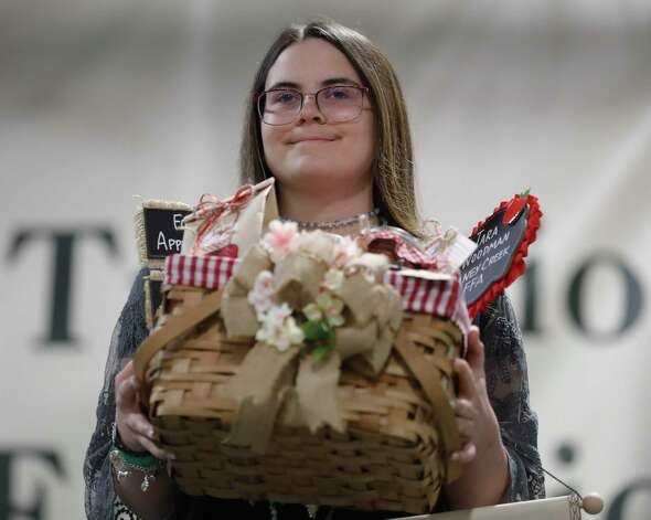 Tara Woodman of Caney Creek FFA won grand champion canned food during the non-livestock auction at the Montgomery County Fair and Rodeo, Monday, April 12, 2021, in Conroe. Photo: Jason Fochtman, Houston Chronicle / Staff Photographer / 2021 © Houston Chronicle