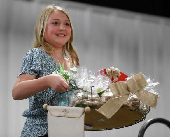 Courtney Pelton of Champion 4-H won grand champion candy during the non-livestock auction at the Montgomery County Fair and Rodeo, Monday, April 12, 2021, in Conroe. Photo: Jason Fochtman, Houston Chronicle / Staff Photographer / 2021 © Houston Chronicle