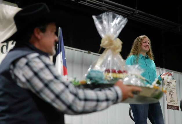 Cora McCartney of Conroe FFA won grand champion cake from scratch during the non-livestock auction at the Montgomery County Fair and Rodeo, Monday, April 12, 2021, in Conroe. Photo: Jason Fochtman, Houston Chronicle / Staff Photographer / 2021 © Houston Chronicle