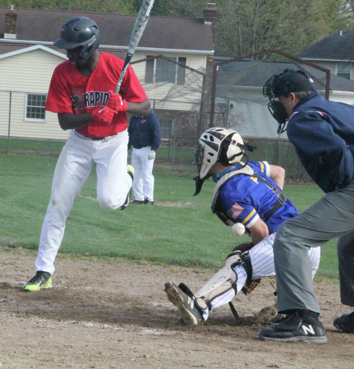 Big Rapids' Jamal Strickland avoids a pitch thrown low and inside against him on Monday at Win Kellum Field against Evart. (Pioneer photo/John Raffel)