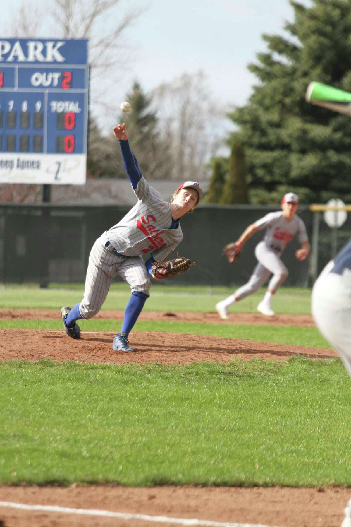 Manistee Catholic Central's Blake Johnson delivers a pitch Monday during a sweep of Brethren. Johnson had 12 strikeouts on the mound. (Dylan Savela/News Advocate)