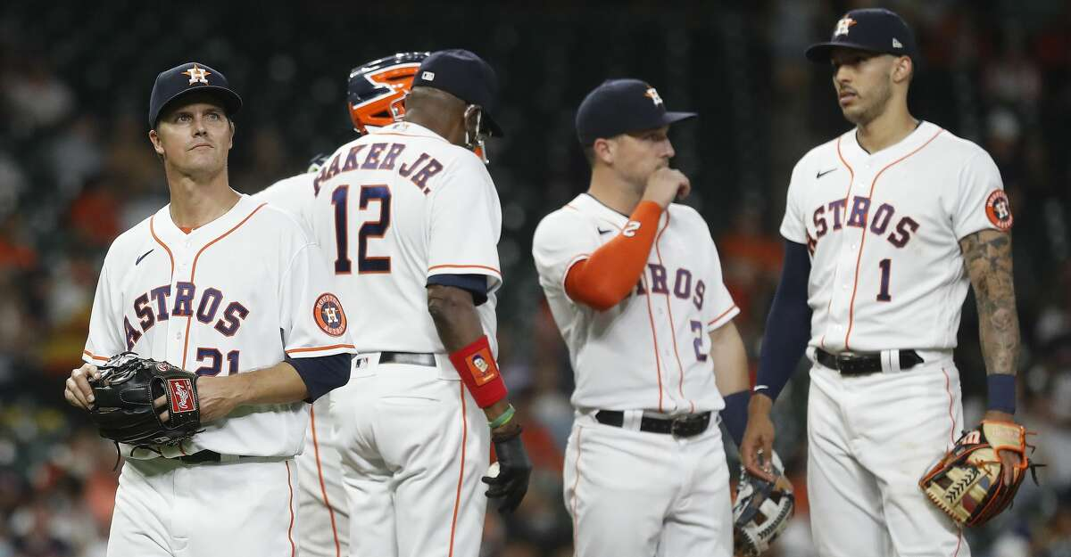 Houston Astros starting pitcher Zack Greinke (21) walks back to the dugout after getting pulled by manager Dusty Baker Jr. during the fifth inning of an MLB baseball game at Minute Maid Park, in Houston, Monday, April 12, 2021.