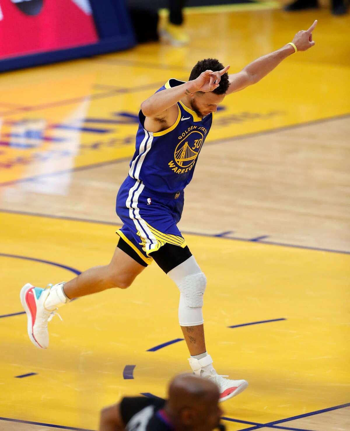 Golden State Warriors' Stephen Curry reacts to passing Wilt Chamberlain as franchise's leading career score after scoring a 1st quarter basket against Denver Nuggets during 1st quarter of NBA game at Chase Center in San Francisco, Calif., on Monday, April 12, 2021.