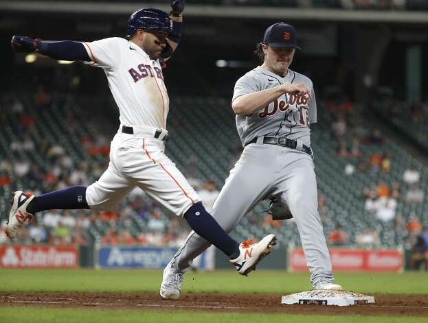 Houston Astros Jose Altuve (27) tries to beat the throw to first as he ground out against Detroit Tigers starting pitcher Casey Mize (12) during the fifth inning of an MLB baseball game at Minute Maid Park, in Houston, Monday, April 12, 2021. Photo: Karen Warren/Staff Photographer / @2021 Houston Chronicle