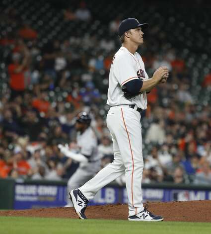 Houston Astros starting pitcher Zack Greinke (21) reacts as Detroit Tigers Akil Baddoo rounds the bases after his home run during the third inning of an MLB baseball game at Minute Maid Park, in Houston, Monday, April 12, 2021. Photo: Karen Warren/Staff Photographer / @2021 Houston Chronicle