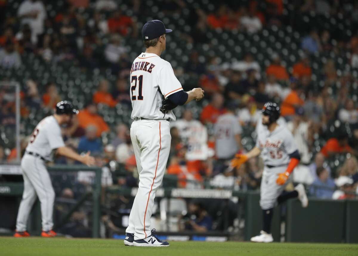 Houston Astros starting pitcher Zack Greinke (21) watches Detroit Tigers Renato Nunez (55) round the bases after his home run during the third inning of an MLB baseball game at Minute Maid Park, in Houston, Monday, April 12, 2021.