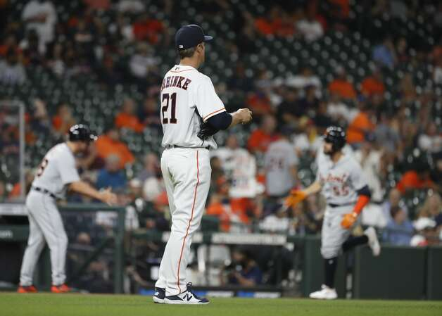 Houston Astros starting pitcher Zack Greinke (21) watches Detroit Tigers Renato Nunez (55) round the bases after his home run during the third inning of an MLB baseball game at Minute Maid Park, in Houston, Monday, April 12, 2021. Photo: Karen Warren/Staff Photographer / @2021 Houston Chronicle