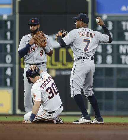 Detroit Tigers second baseman Jonathan Schoop (7) fails to get the throw to first after tagging Houston Astros Kyle Tucker (30) on Myles Straw's single during the second inning of an MLB baseball game at Minute Maid Park, in Houston, Monday, April 12, 2021. Photo: Karen Warren/Staff Photographer / @2021 Houston Chronicle