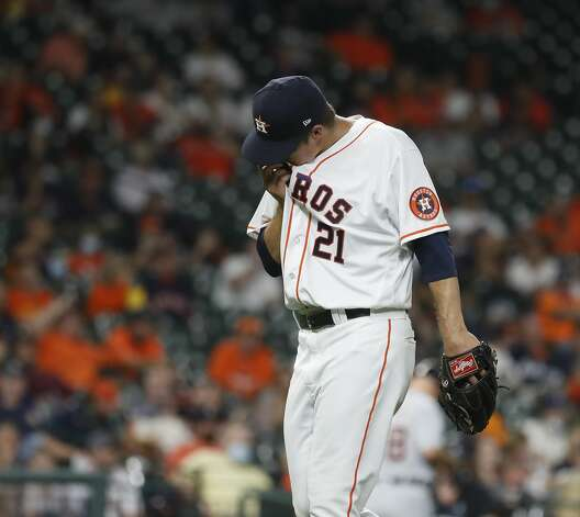 Houston Astros starting pitcher Zack Greinke (21) walks back to the dugout after getting pulled by manager Dusty Baker Jr. during the fifth inning of an MLB baseball game at Minute Maid Park, in Houston, Monday, April 12, 2021. Photo: Karen Warren/Staff Photographer / @2021 Houston Chronicle