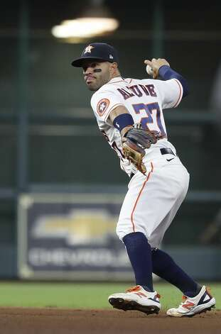 Houston Astros second baseman Jose Altuve (27) fields Detroit Tigers Willi Castro's ground out during the fourth inning of an MLB baseball game at Minute Maid Park, in Houston, Monday, April 12, 2021. Photo: Karen Warren/Staff Photographer / @2021 Houston Chronicle