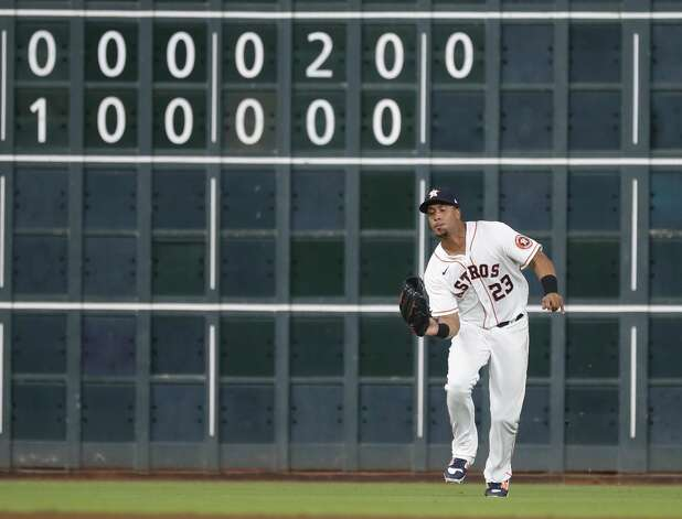 Houston Astros left fielder Michael Brantley (23) catches Detroit Tigers Robbie Grossman's fly out during the fourth inning of an MLB baseball game at Minute Maid Park, in Houston, Monday, April 12, 2021. Photo: Karen Warren/Staff Photographer / @2021 Houston Chronicle