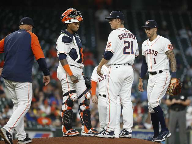 Houston Astros starting pitcher Zack Greinke (21) waits for pitching coach Brent Strom during the second inning of an MLB baseball game at Minute Maid Park, in Houston, Monday, April 12, 2021. Photo: Karen Warren/Staff Photographer / @2021 Houston Chronicle