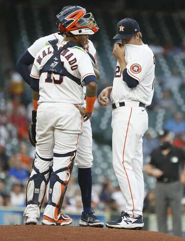 Houston Astros starting pitcher Zack Greinke (21) chats with catcher Martin Maldonado (15) and Carlos Correa (1) during the first inning of an MLB baseball game at Minute Maid Park, in Houston, Monday, April 12, 2021. Photo: Karen Warren/Staff Photographer / @2021 Houston Chronicle