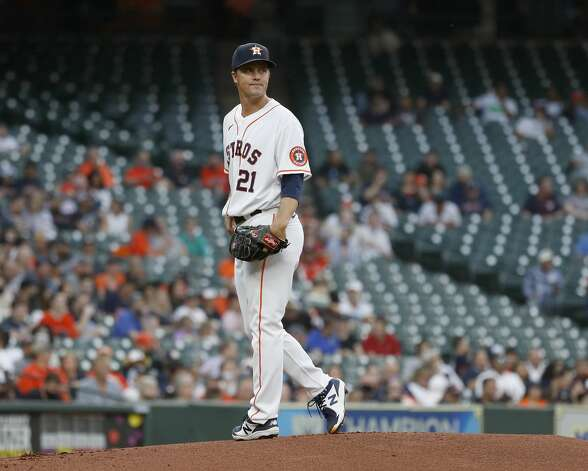 Houston Astros starting pitcher Zack Greinke (21) looks back at first base after walking Detroit Tigers Jeimer Candelario during the first inning of an MLB baseball game at Minute Maid Park, in Houston, Monday, April 12, 2021. Photo: Karen Warren/Staff Photographer / @2021 Houston Chronicle
