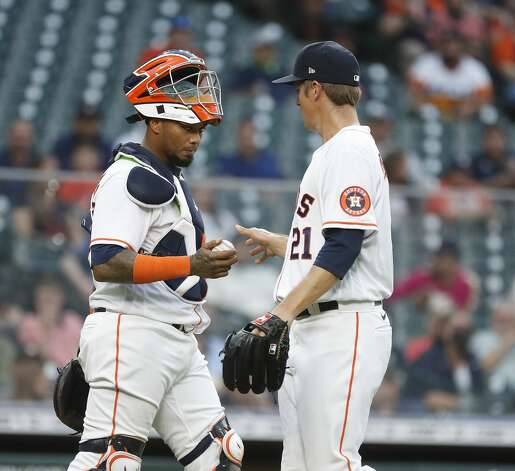 Houston Astros starting pitcher Zack Greinke (21) chats with catcher Martin Maldonado (15) during the first inning of an MLB baseball game at Minute Maid Park, in Houston, Monday, April 12, 2021. Photo: Karen Warren/Staff Photographer / @2021 Houston Chronicle