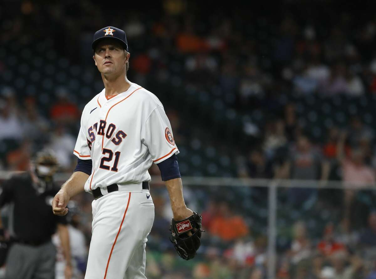 Houston Astros starting pitcher Zack Greinke (21) walks back to the dugout after the second inning of an MLB baseball game at Minute Maid Park, in Houston, Monday, April 12, 2021.