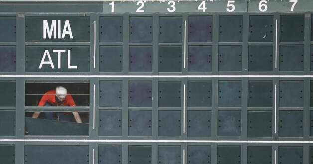 A scoreboard operator before the start of the first inning of an MLB baseball game at Minute Maid Park, in Houston, Monday, April 12, 2021. Photo: Karen Warren/Staff Photographer / @2021 Houston Chronicle