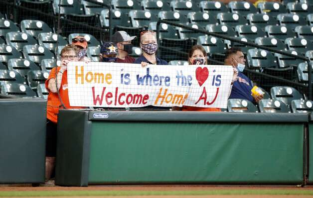 Astros fans hold up a sign for Detroit Tigers manager A.J. Hinch during batting practice before the start of an MLB baseball game at Minute Maid Park, in Houston, Monday, April 12, 2021. Photo: Karen Warren/Staff Photographer / @2021 Houston Chronicle