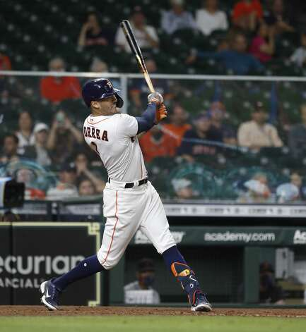 Houston Astros Carlos Correa (1) hits a solo home run during the ninth inning of an MLB baseball game at Minute Maid Park, in Houston, Monday, April 12, 2021. Photo: Karen Warren/Staff Photographer / @2021 Houston Chronicle