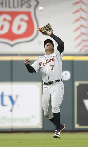 Detroit Tigers second baseman Jonathan Schoop (7) catches Houston Astros Robel Garcia's pop out during the ninth inning of an MLB baseball game at Minute Maid Park, in Houston, Monday, April 12, 2021. Astros lose to the Detroit Tigers 6-2. Photo: Karen Warren/Staff Photographer / @2021 Houston Chronicle