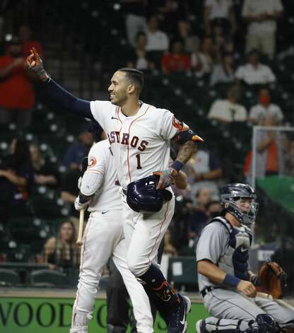 Houston Astros Carlos Correa (1) celebrates after his solo home run during the ninth inning of an MLB baseball game at Minute Maid Park, in Houston, Monday, April 12, 2021. Photo: Karen Warren/Staff Photographer / @2021 Houston Chronicle
