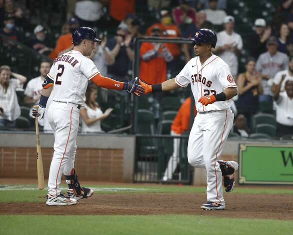 Houston Astros Michael Brantley celebrates his home run with Alex Bregman (2) during the eighth inning of an MLB baseball game at Minute Maid Park, in Houston, Monday, April 12, 2021. Photo: Karen Warren/Staff Photographer / @2021 Houston Chronicle