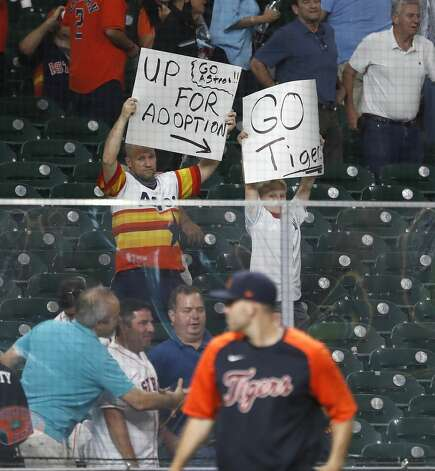 An Astros dad with his Detroit Tigers son in the stands during the ninth inning of an MLB baseball game at Minute Maid Park, in Houston, Monday, April 12, 2021. Astros lose to the Detroit Tigers 6-2. Photo: Karen Warren/Staff Photographer / @2021 Houston Chronicle