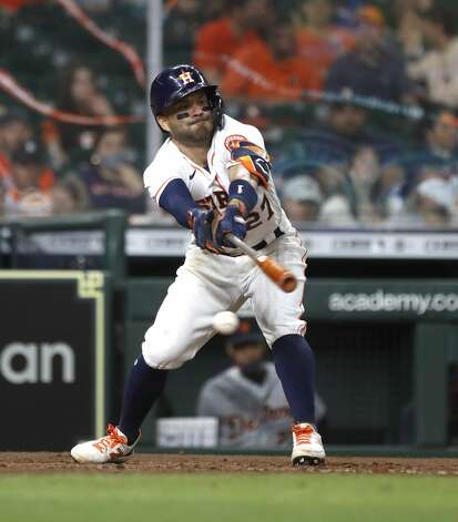 Houston Astros Jose Altuve (27) reaches as he struck out during the eighth inning of an MLB baseball game at Minute Maid Park, in Houston, Monday, April 12, 2021. Photo: Karen Warren/Staff Photographer / @2021 Houston Chronicle