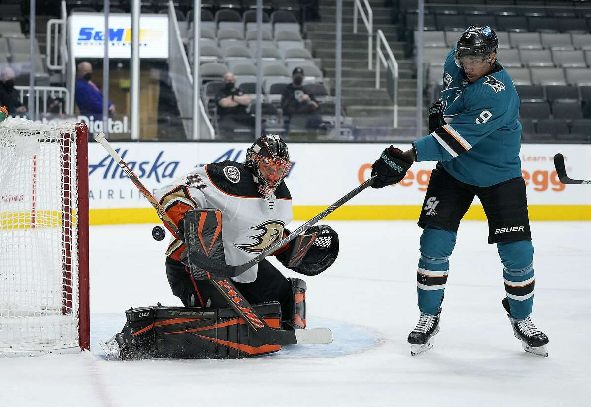 Anaheim Ducks goaltender Anthony Stolarz blocks a shot by San Jose Sharks left wing Evander Kane during the first period Monday night.