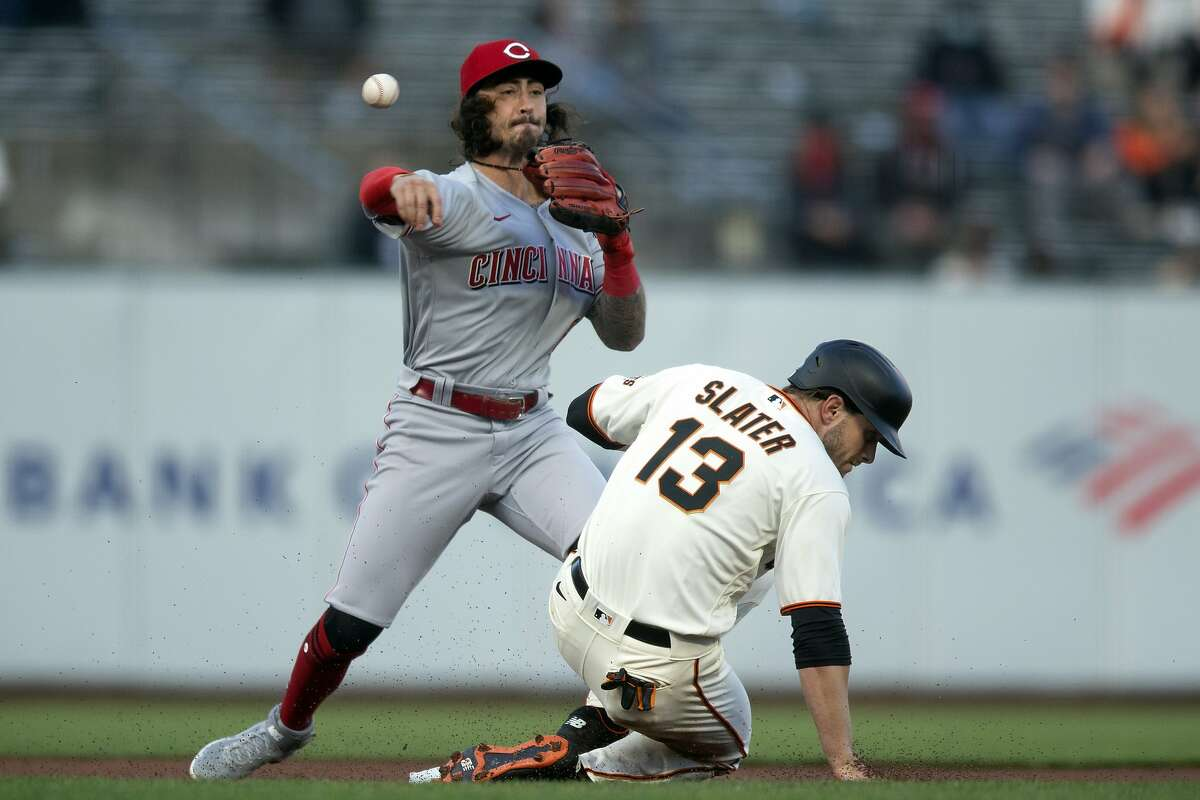 Cincinnati Reds second baseman Jonathan India (6) throws over San Francisco Giants' Austin Slater (13) too late to double up Donovan Solano at first during the first inning of a baseball game, Monday, April 12, 2021, in San Francisco, Calif.
