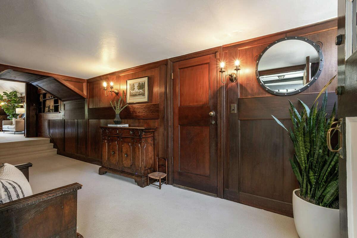 Dark wood paneling and furnishings highlight the original 1800s design.