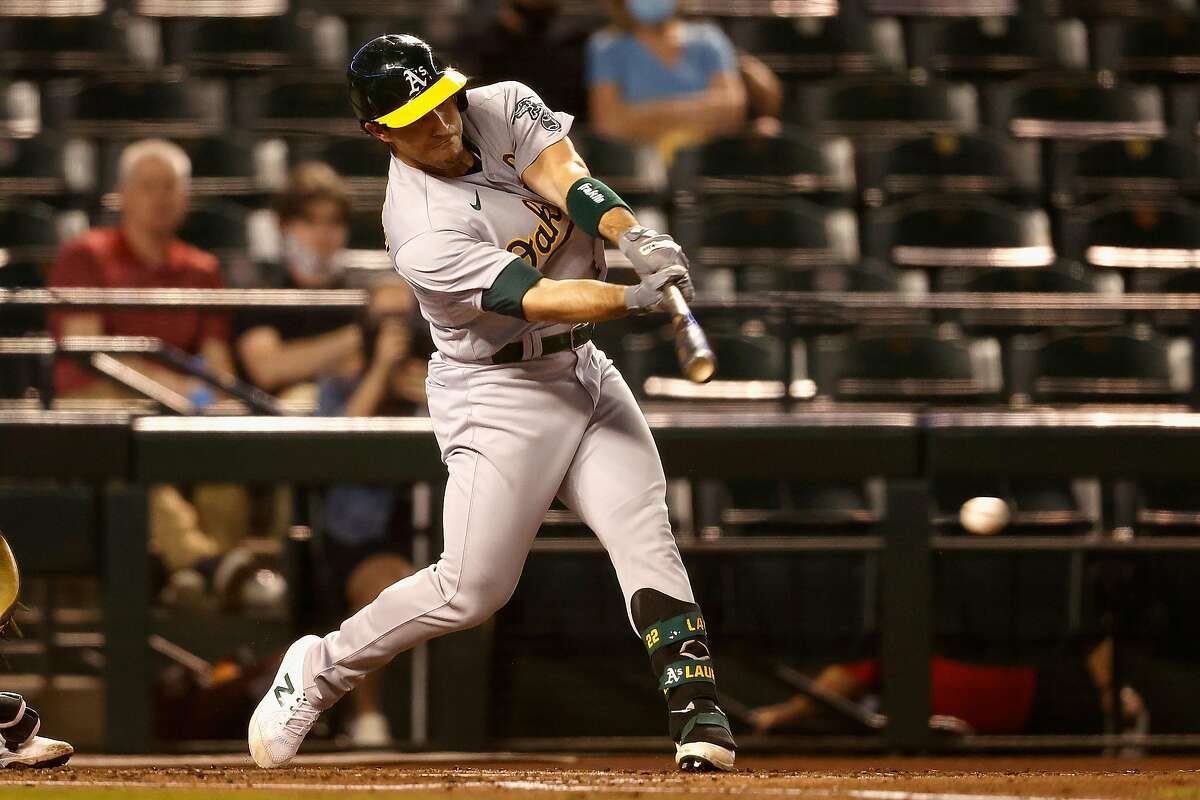 PHOENIX, ARIZONA - APRIL 12: Ramon Laureano #22 of the Oakland Athletics hits a single against the Arizona Diamondbacks during the third inning of the MLB game at Chase Field on April 12, 2021 in Phoenix, Arizona. (Photo by Christian Petersen/Getty Images)