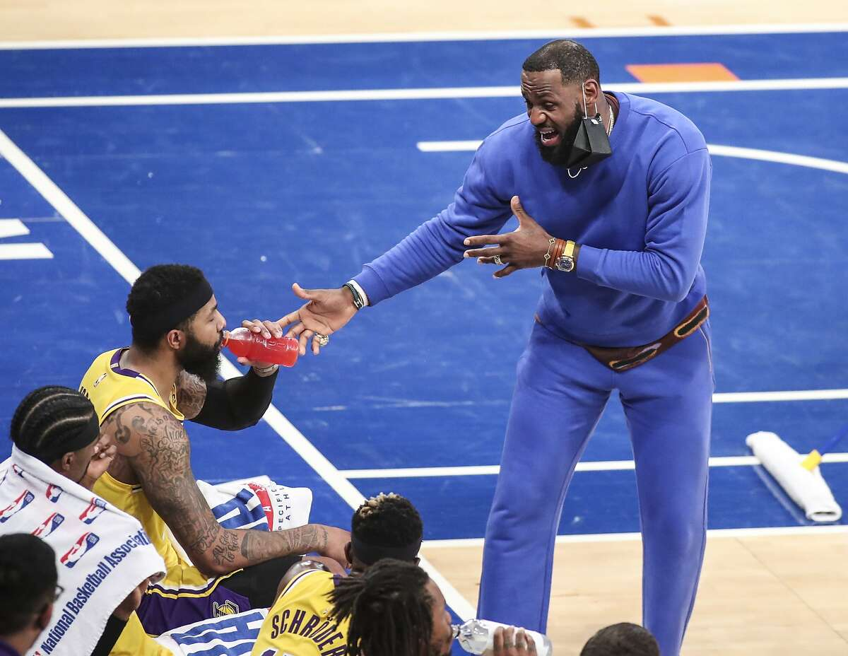 LeBron James, in street clothes with an ankle sprain, exhorts his Lakers teammates during a 111-96 loss to New York.