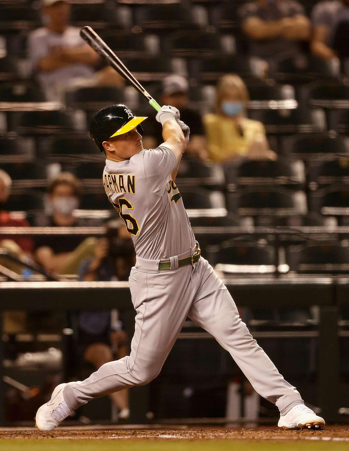PHOENIX, ARIZONA - APRIL 12: Matt Chapman #26 of the Oakland Athletics hits a solo home run against the Arizona Diamondbacks during the fifth inning of the MLB game at Chase Field on April 12, 2021 in Phoenix, Arizona. (Photo by Christian Petersen/Getty Images)