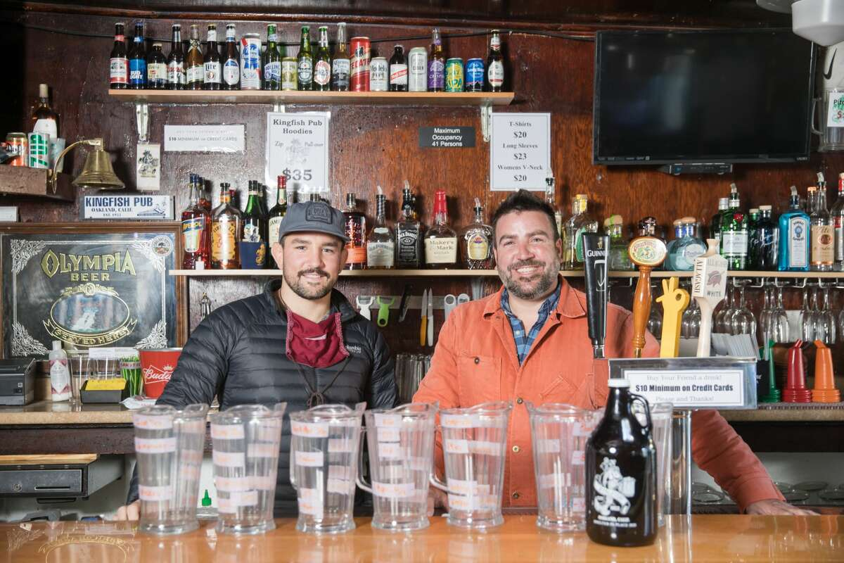 Co-owners Gian Traverso, left,and Vincent Traverso behind the bar at the Kingfish Pub in Oakland, Calif., on April 6, 2021.