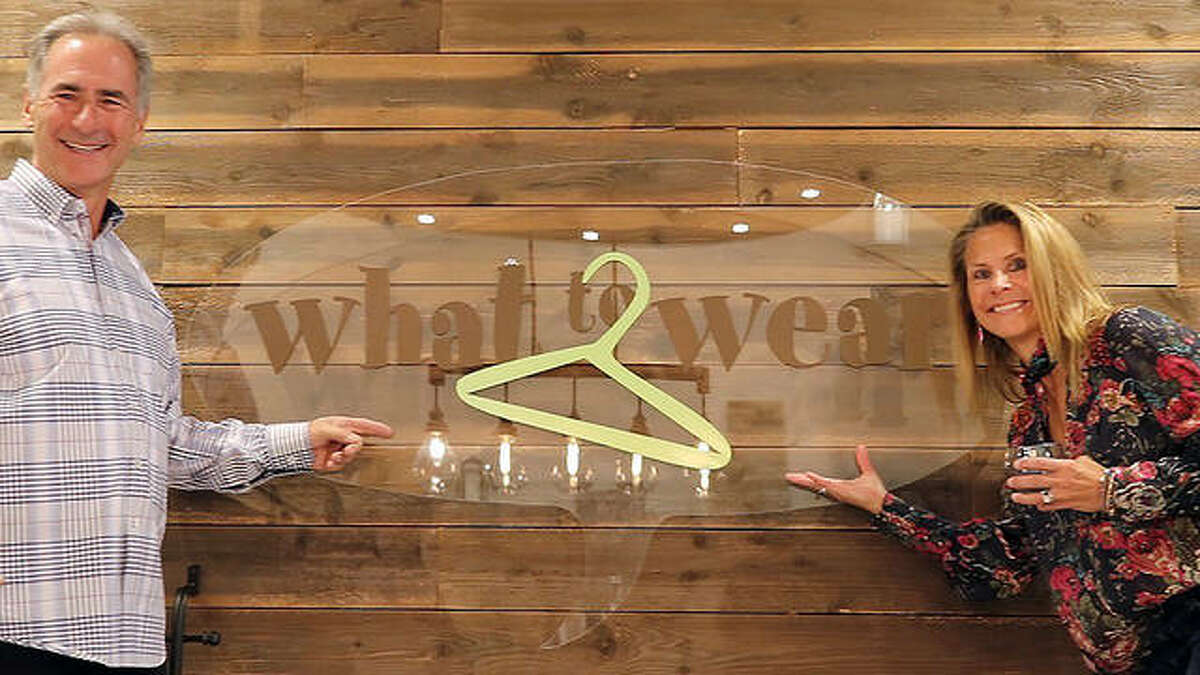 """Edwardsville graduate Jerri (Foehrkolb) Roush and her husband Steve at their """"What to Wear"""" clothing boutique in Colorado Springs, Colorado, during its first anniversary in 2018."""