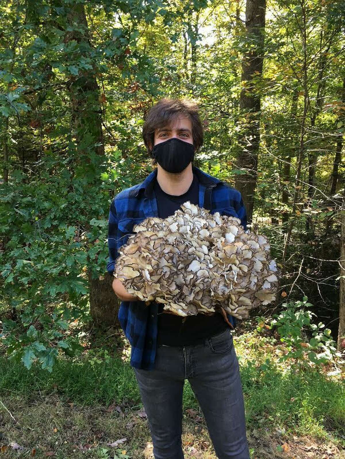 Griffin Kalin with hen of the woods.