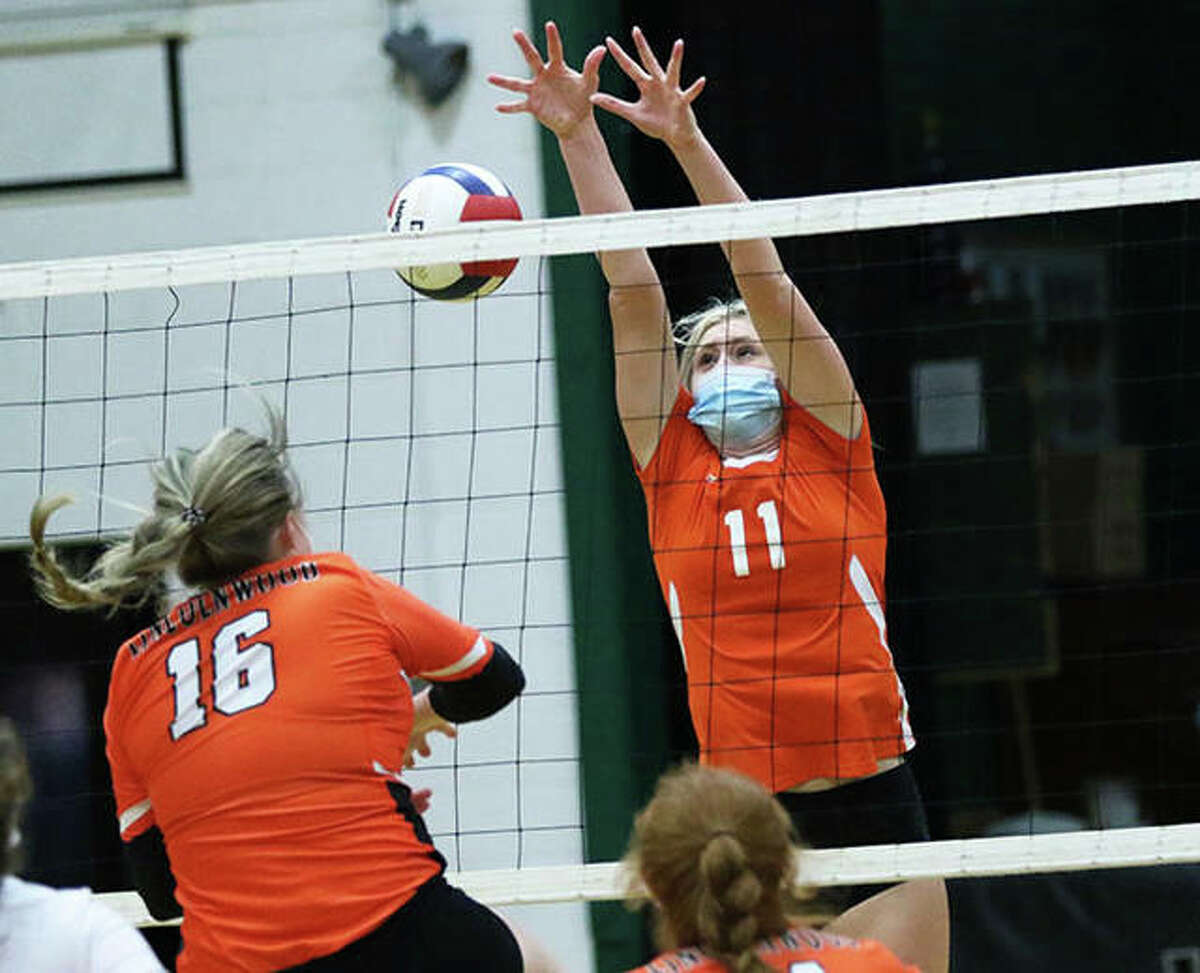 Raymond Lincolnwood's Katelyn Payne (16) hits off the block by Greenfield's Kersty Gibbs (11) on Monday in Palmyra.