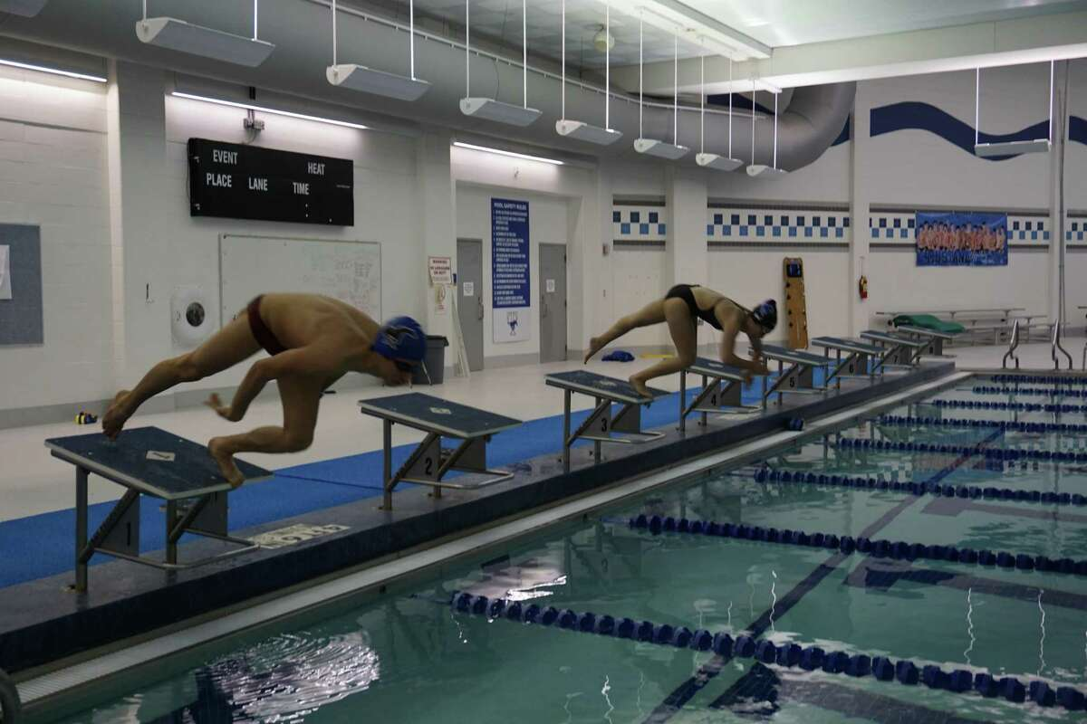 Taylor High School swimmers Gerardo Angulo, left, and Mariana Diaz start a lap on Thursday, April 8, at the Taylor natatorium in Katy. Voters approved a bond issue for a new natatorium at High School No. 10 at a total cost of more than $13.8 million.