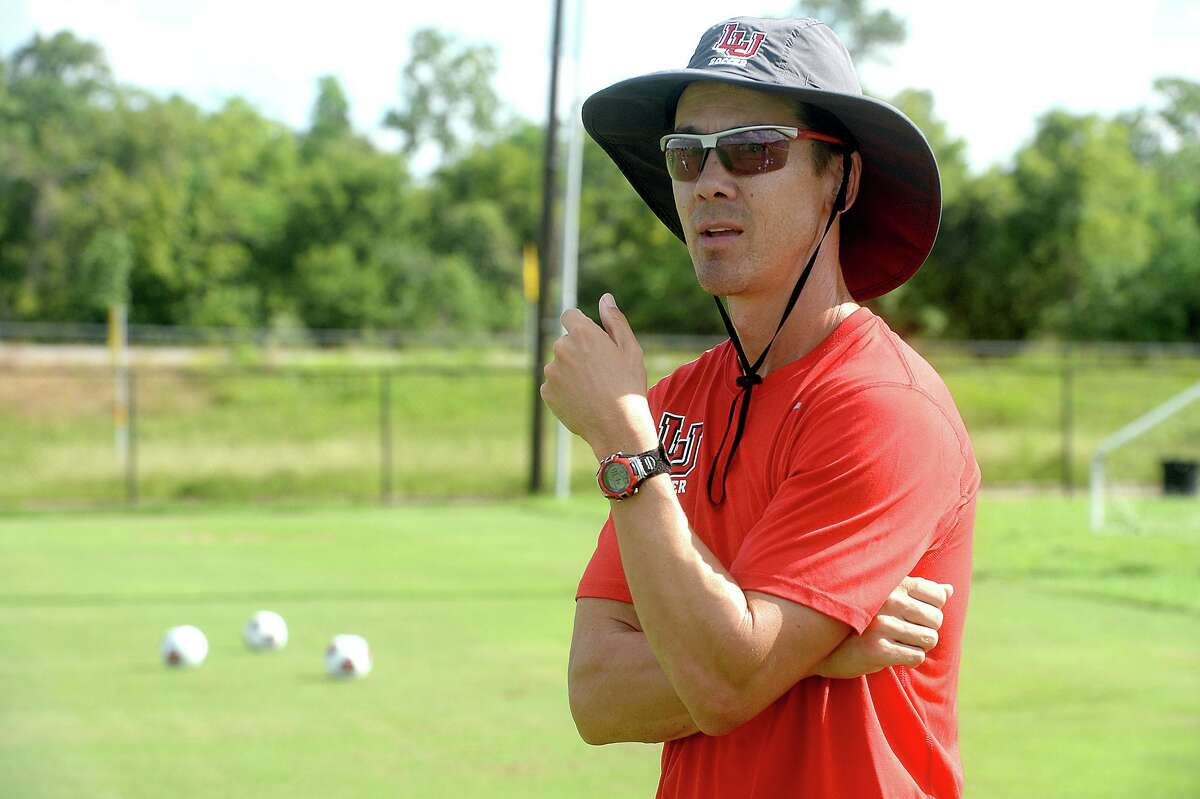 Lamar University's new head soccer coach Steve Holeman watches as his players run drills during practice Tuesday. Holeman, who is known for building strong programs, is looking to leave a similar mark on the Cardinals as they enter their tenth season. Photo taken Tuesday, August 23, 2016 Kim Brent/The Enterprise