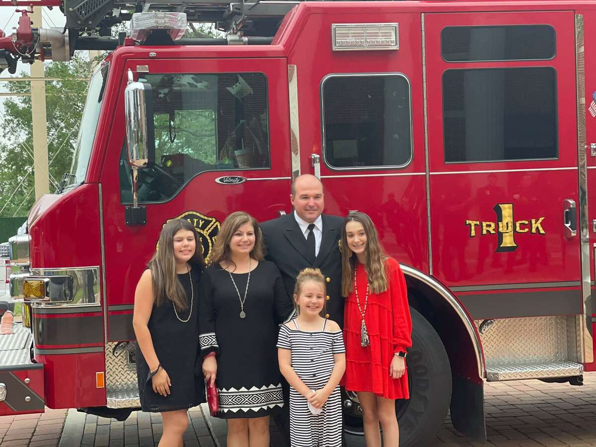 New Katy Fire Department Chief Kenneth Parker poses with his family after his appointment as chief on April 12, 2021.