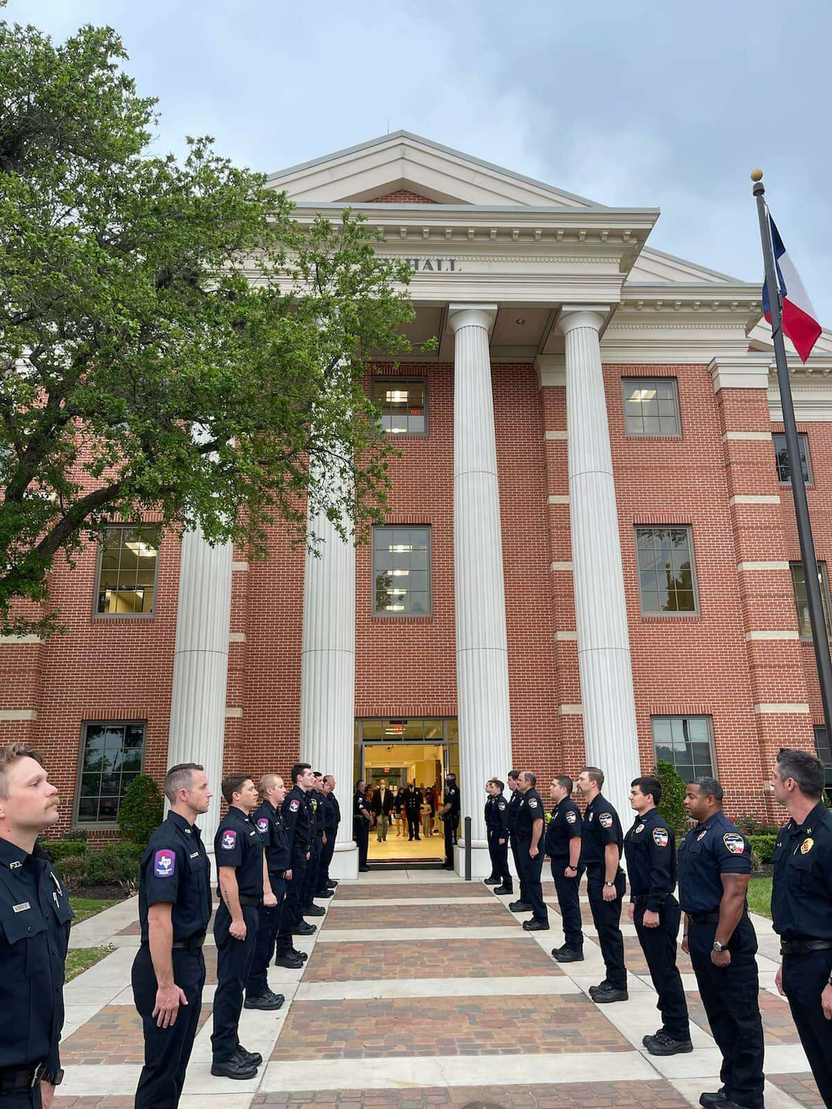 Katy Fire Department firefighters line up outside Katy City Hall to honor the appointment of Kenneth Parker as fire chief on April 12, 2021