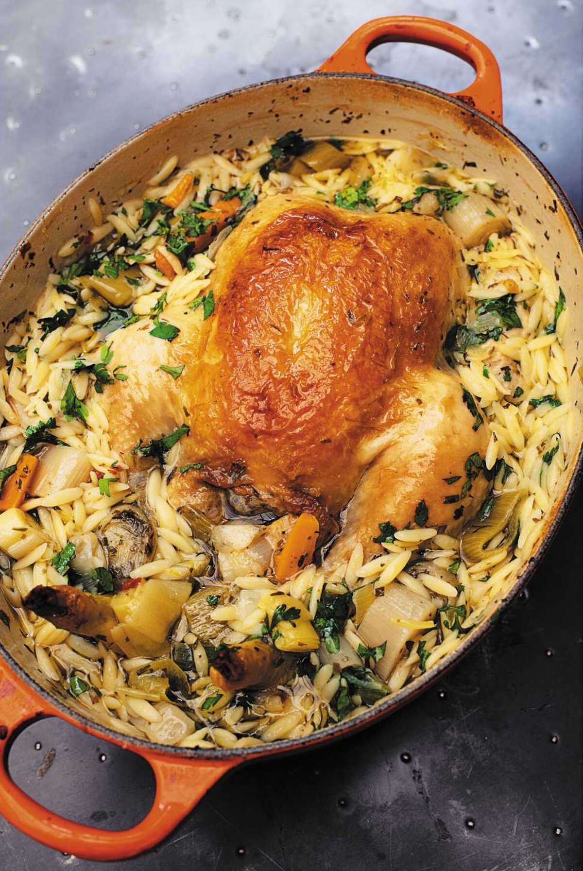 """Chicken in a Pot with Lemon and Orzo from """"Cook, Eat, Repeat: Ingredients, Recipes, and Stories"""" by Nigella Lawson."""