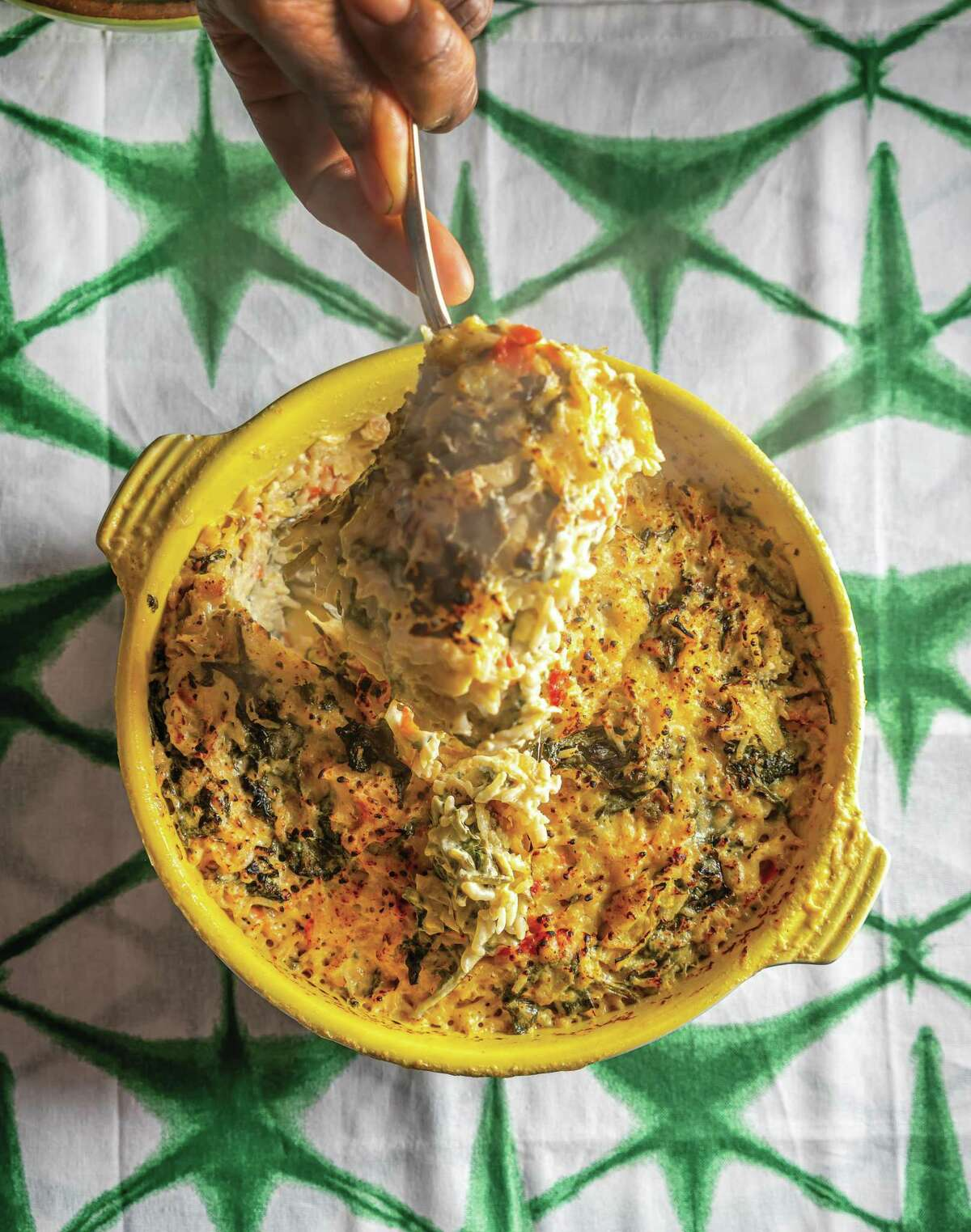 """Grandma Lue's Spinach Rice from """"The Twisted Soul Cookbook: Modern Soul Food with Global Flavors"""" by Deborah VanTrece."""