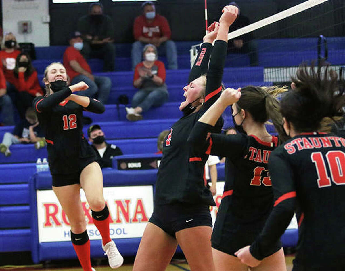 Staunton's Taryn Russell (second left), Haris Legendre (left), Hannah Dustman and Emily Hasquin (10) celebrate a point in a March 22 win at Roxana. On Monday, the unbeaten Dogs had more to celebrate with a win over Carlinville that wrapped up a 9-0 run to the SCC championship.