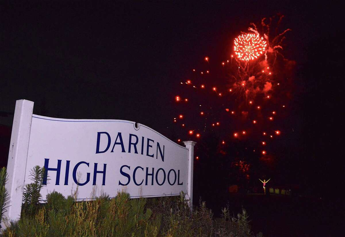 Skyrockets burst over the school at the annual fireworks celebration at Darien High School, Sunday, July 2, 2017, in Darien, Conn.