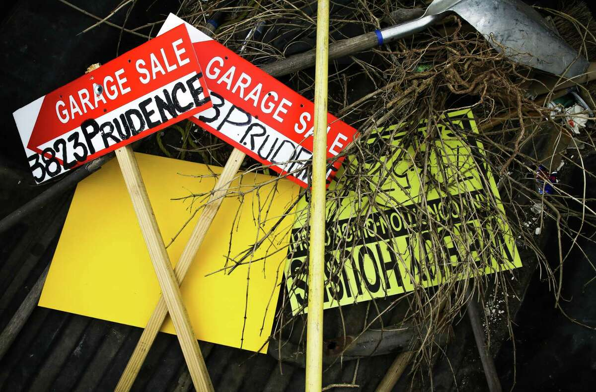 Bandit signs are placed on the back of a truck after the District K cleanup team finds and removed the signs from lawns and electrical poles, on April 10, 2021, in Houston.