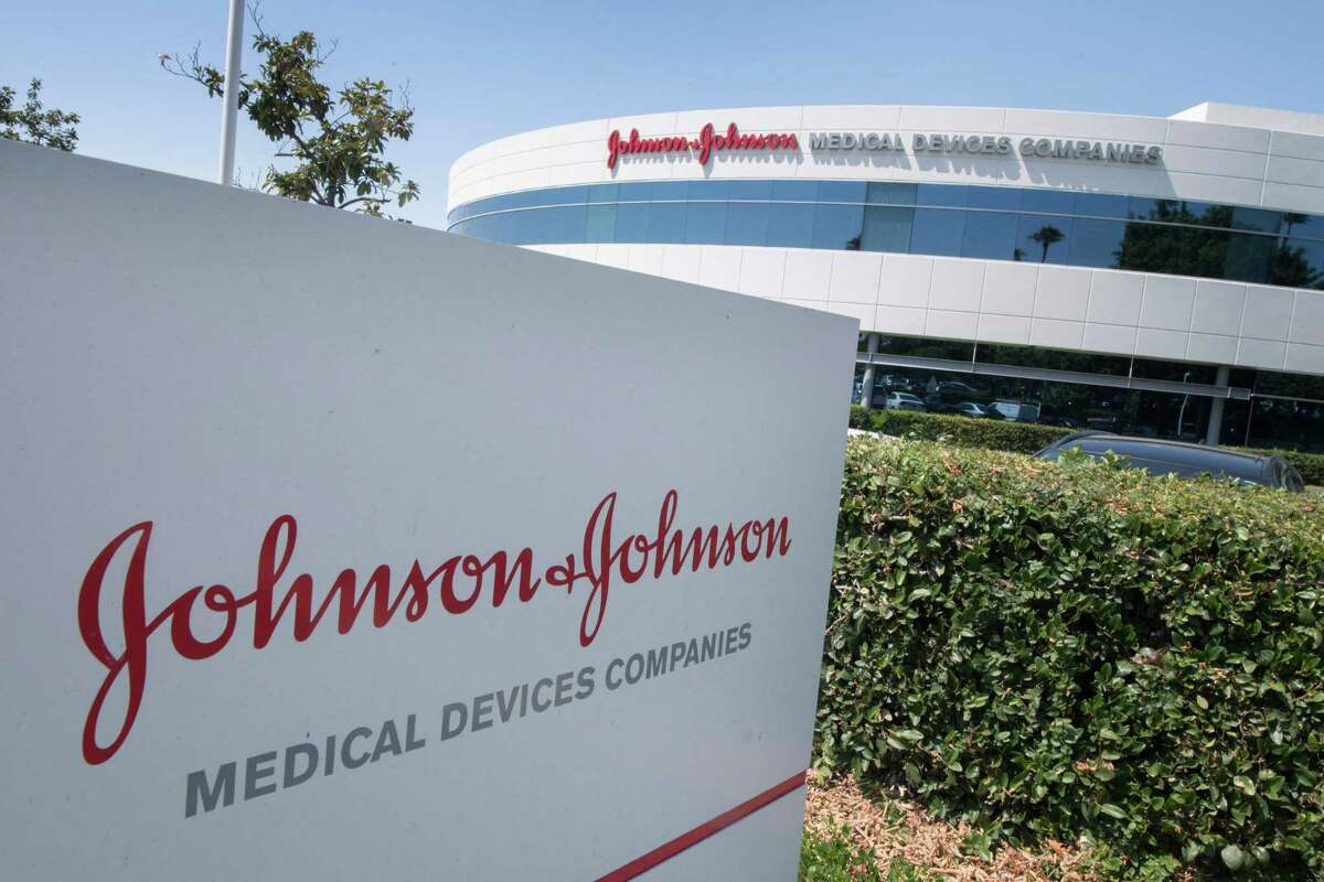 """(FILES) In this file photo taken on August 28, 2019 the entry sign to the Johnson & Johnson campus shows their logo in Irvine, California. - Top US health authorities recommended a """"pause"""" in the use of the Johnson & Johnson Covid-19 vaccine """"out of an abundance of caution"""" as they investigate any links between it and blood clots, a regulator said on April 13, 2021. The US Food and Drug Administration and the Centers for Disease Control are assessing the """"potential significance"""" of six reported cases of a rare blood clot in patients who have received the shot, the FDA tweeted. (Photo by Mark RALSTON / AFP) (Photo by MARK RALSTON/AFP via Getty Images)"""