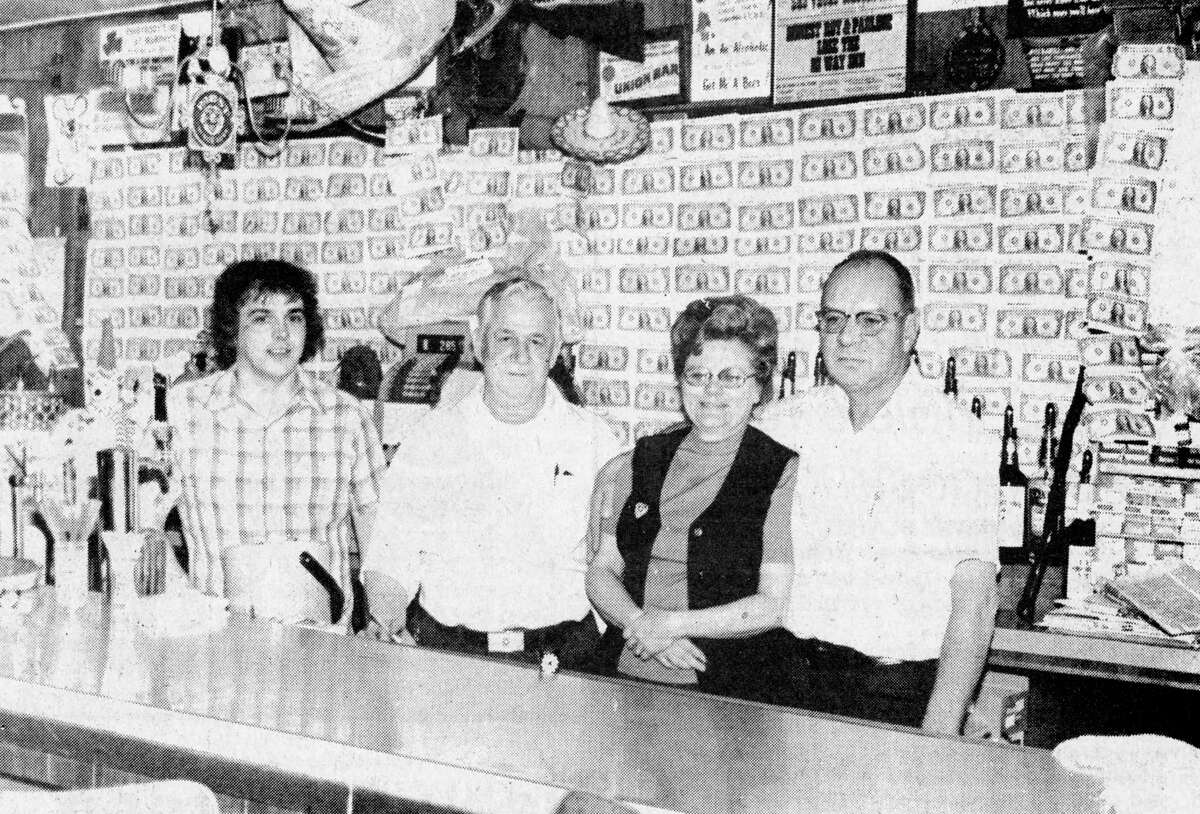 Patrons of the Hi-Way Inn on Kosciusko Street have donated $260 to the American Cancer Society. Standing in the front of the $1 bills that were pasted on the bar's mirror are (from left) bartenders Dan Schultz and Harry Tetzlaff and Hi-Way Inn proprietors Pauline and Roy Rathbun. The photo was published in the News Advocate onApril 15, 1981.